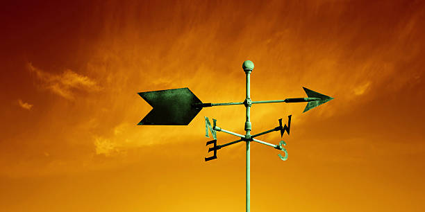 XL weather vane copper weather vane with colorful sunset sky, panoramic frame (XL) weather vane stock pictures, royalty-free photos & images
