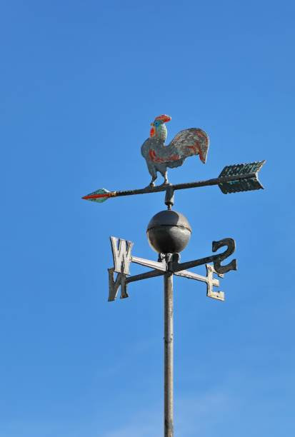 weather vane to indicate wind direction cock-like weather vane to indicate wind direction weather vane stock pictures, royalty-free photos & images