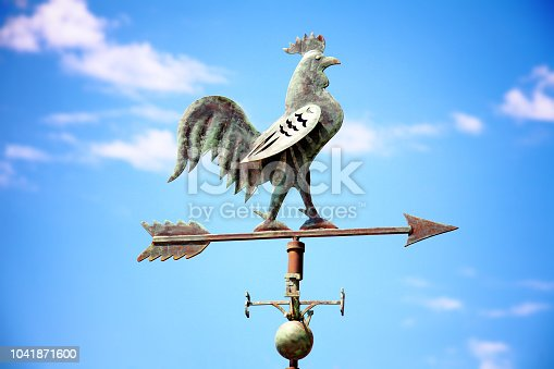 istock Weather vane with the image of a cock 1041871600