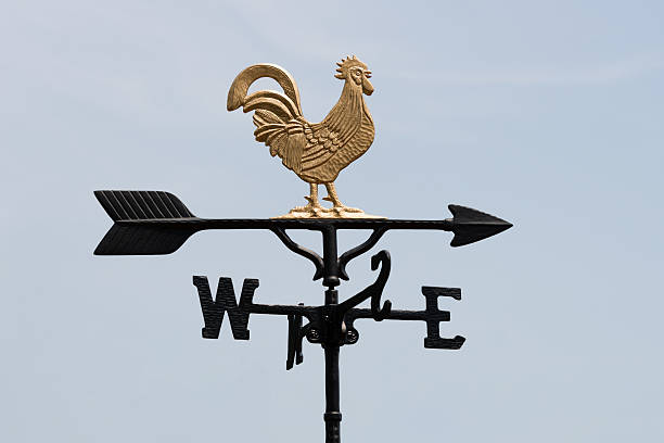 Weathercock (XXXLarge) A weathercock against blue sky. (XXXLarge) weather vane stock pictures, royalty-free photos & images