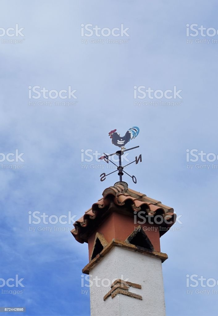 Weathercock weather vane blue sky direction compass stock photo