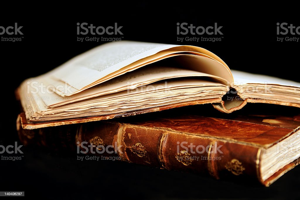 Weathered and worn set of books with brown covers royalty-free stock photo