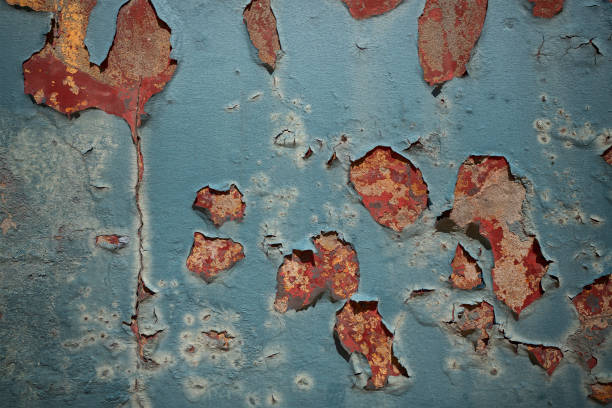 Weathered blue wall with pealing paint stock photo