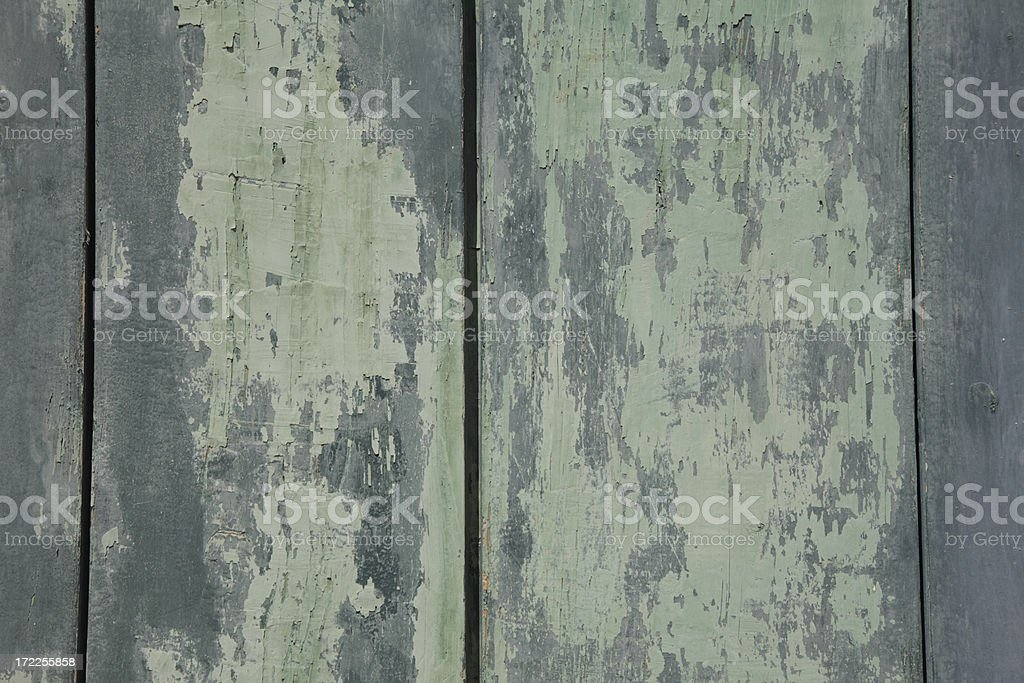 Weathered boards with peeling paint. stock photo