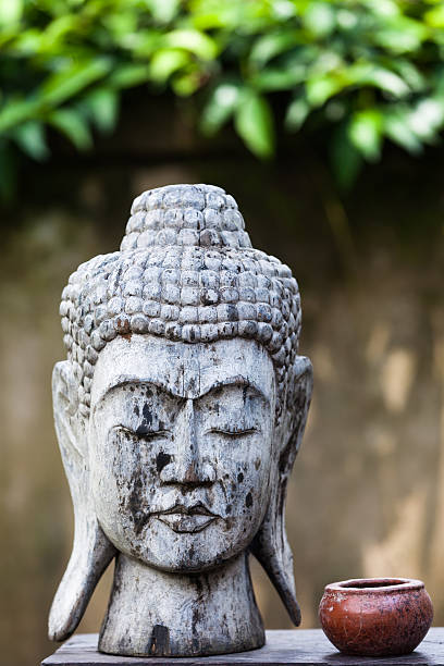 weathered carved buddha head - carolinemaryan stock pictures, royalty-free photos & images