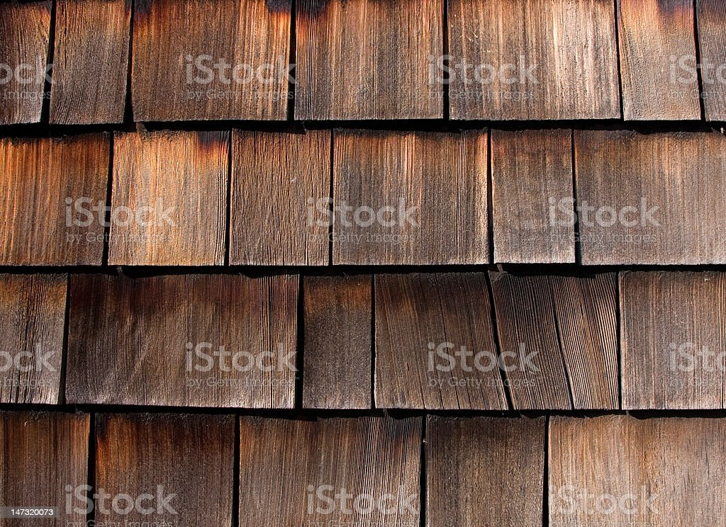 Weathered Cedar Shakes on an old House stock photo