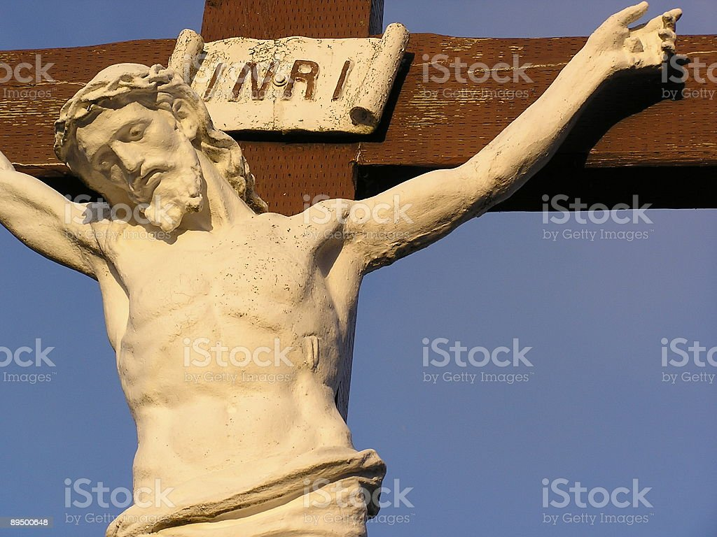 Weathered Christ Statue on Cross Close-up royalty-free stock photo