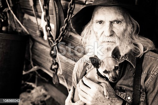 Southwestern cowboy standing by old cabin in Jerome, Arizona.  Great expressive face.