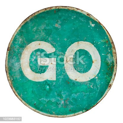 Weathered damaged green road sign with the text go isolated on a white background