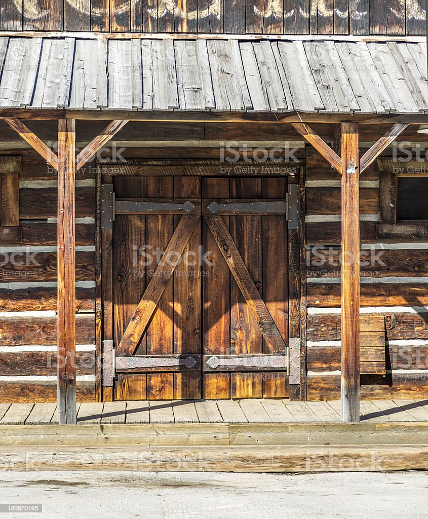 Weathered doorway to a old western building stock photo