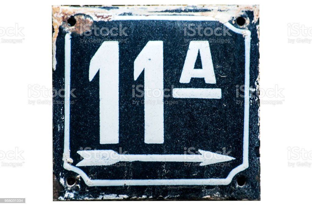 Weathered enameled plate number 11 stock photo