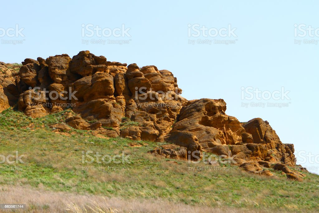 Weathered eroded stones on the hill slope stock photo