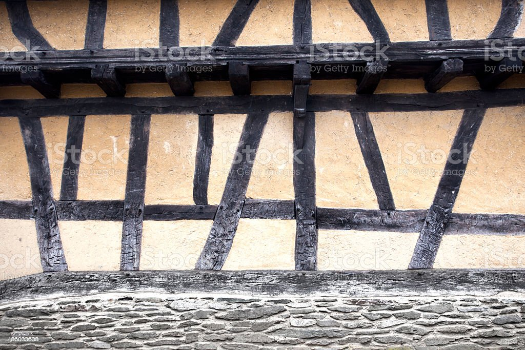 Weathered facade of an old half-timbered house stock photo
