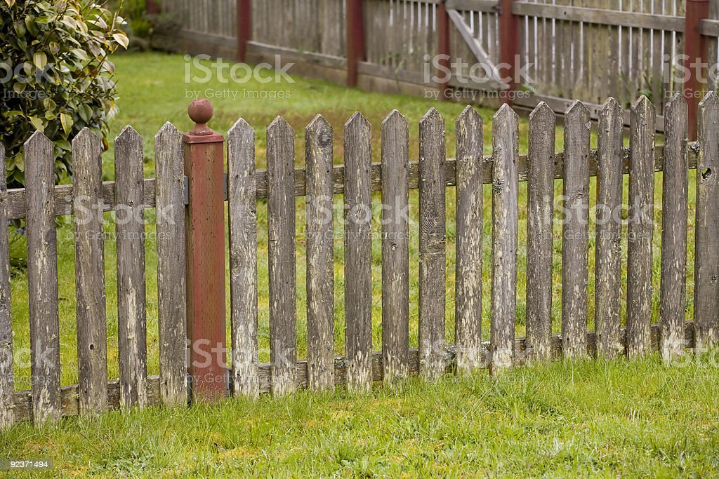 Weathered Fence and Green Grass royalty-free stock photo