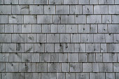 Exterior of a weathered gray cedar shingle wall