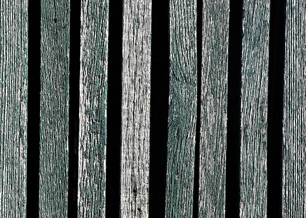 weathered green wood slats on barn stock photo