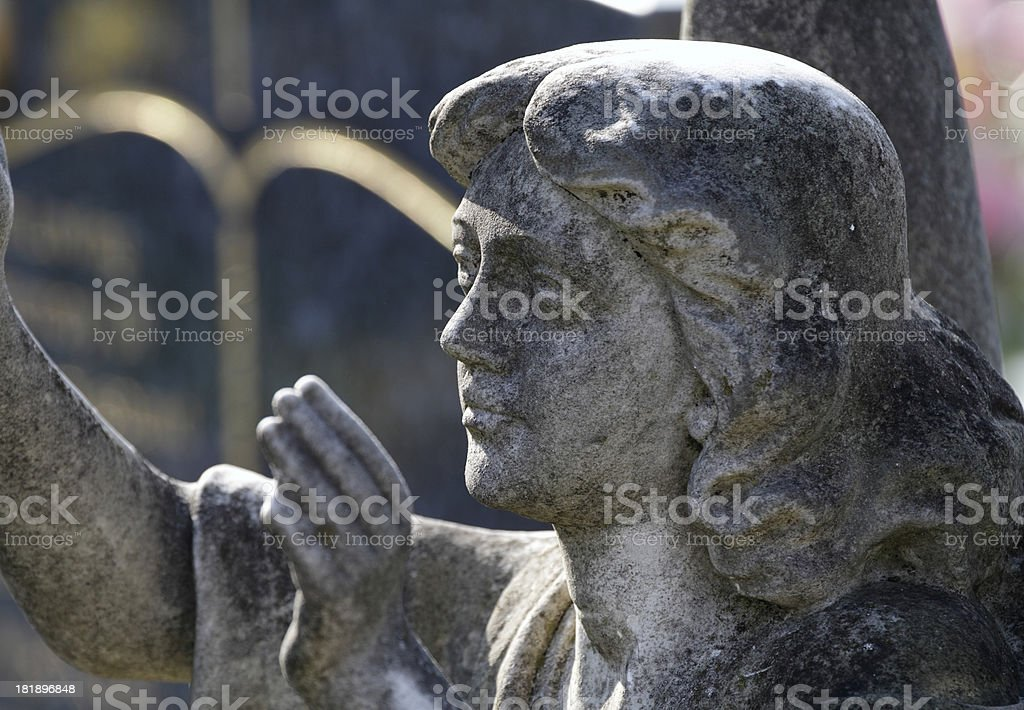 Blessing from backlit grey stone angel royalty-free stock photo