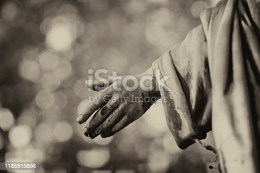 istock Weathered Holy statue on a Cemetery 1185815856