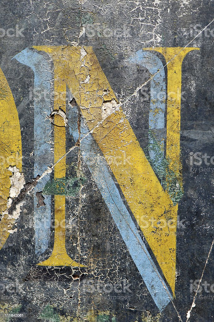 Weathered Letter N on old sign Paris France royalty-free stock photo