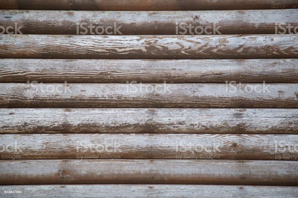 weathered log cabin wall stock photo