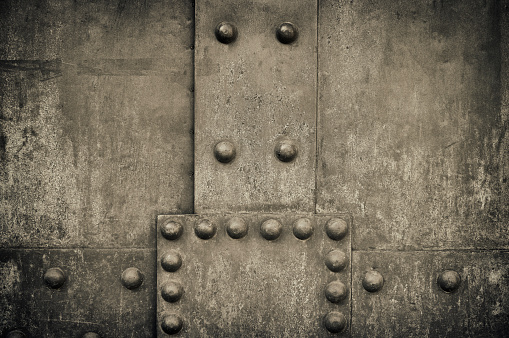 Weathered metal background with rivets, high-res photograph.