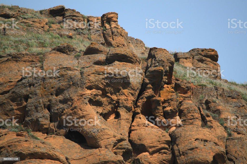 Weathered mountain cliffs on Bogdo mountain stock photo