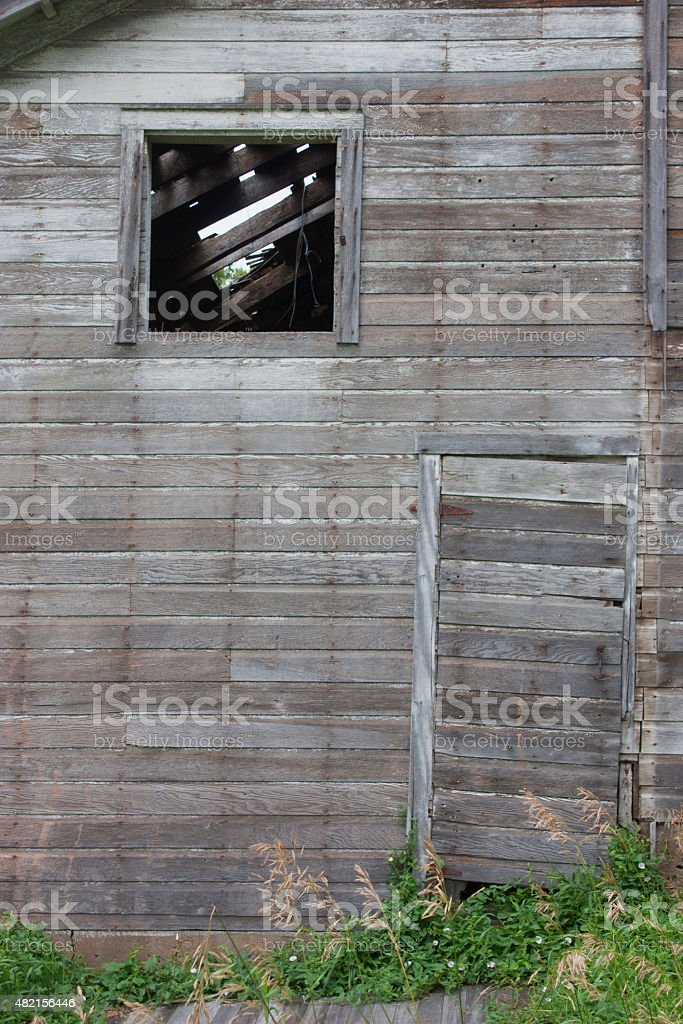 Weathered old barn side with window and door stock photo