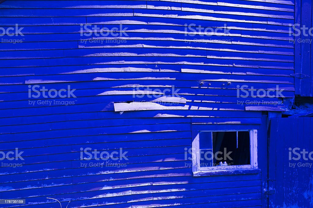 Weathered old blue barn at night royalty-free stock photo