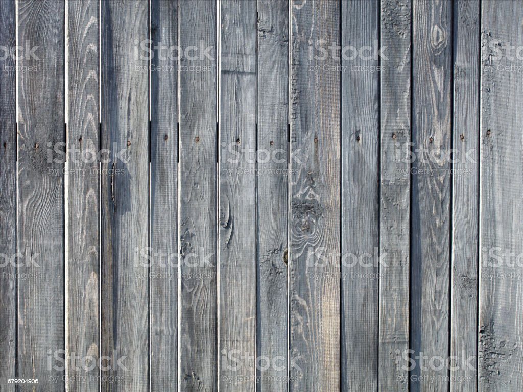 Weathered old gray wooden fence stock photo