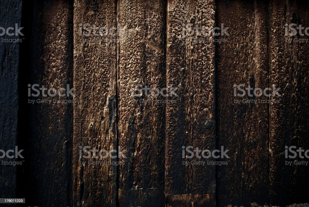 Weathered old wooden planks, black with tar royalty-free stock photo