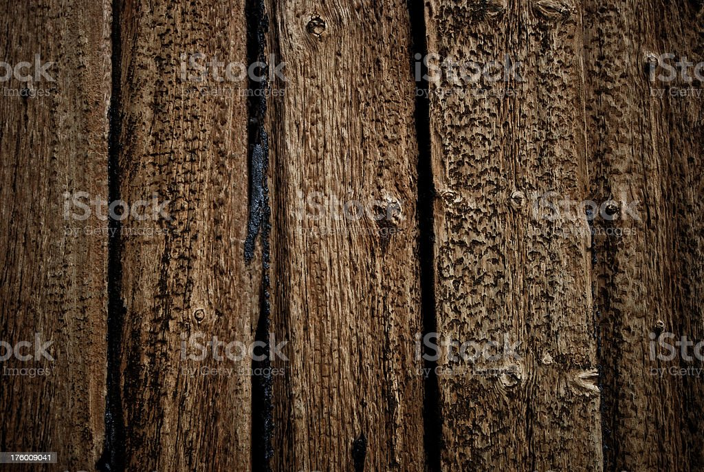 Weathered old wooden planks with tar running royalty-free stock photo