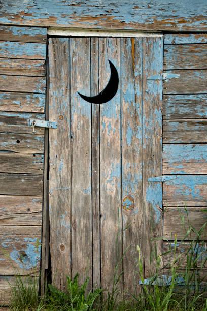 Weathered Outhouse stock photo