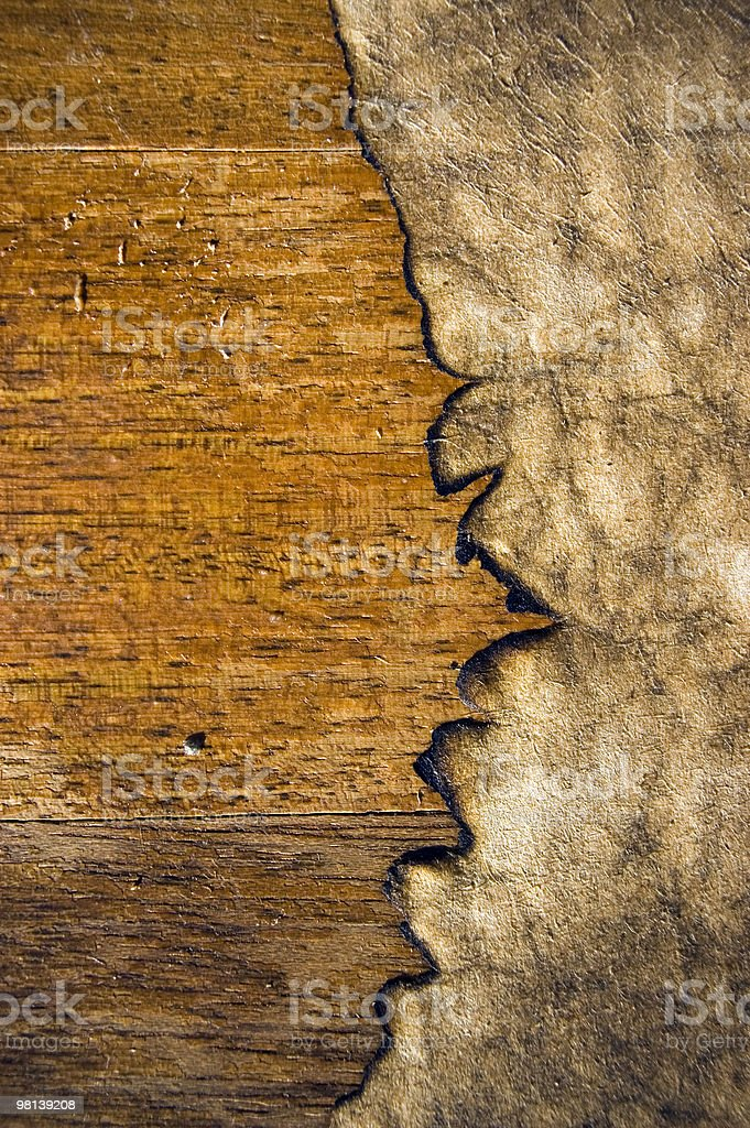 weathered paper on an old wooden texture royalty-free stock photo