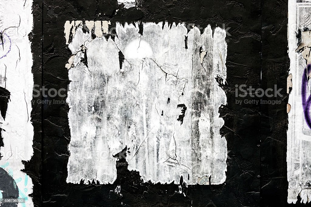 Weathered poster on wall. stock photo