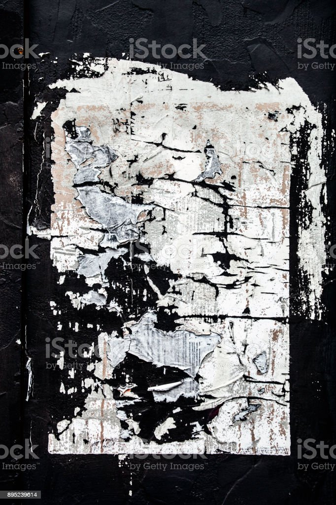 Weathered poster on wall stock photo