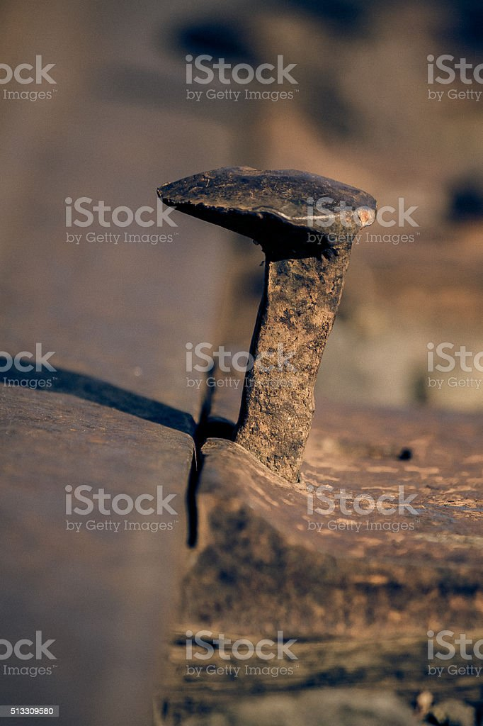Weathered Railroad Spike stock photo