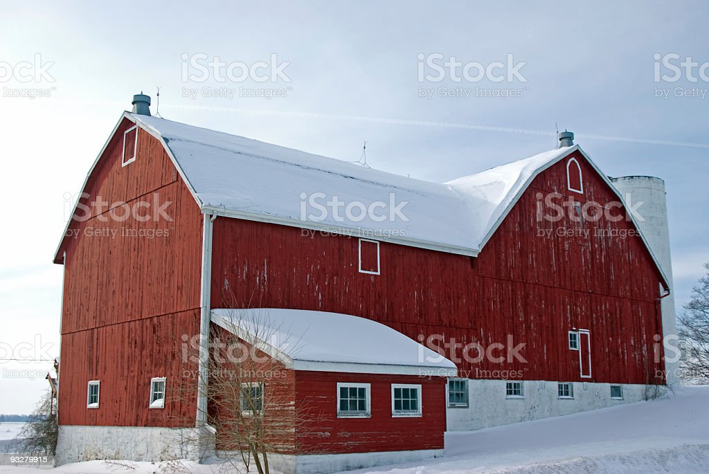Weathered Red Barn in Winter stock photo