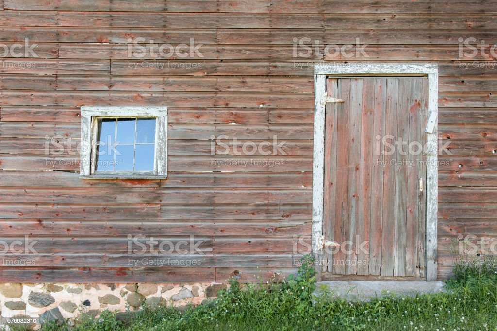 Weathered Red Door and Window stock photo