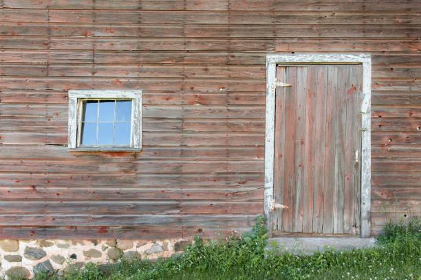 Weathered Red Door and Window stock photo