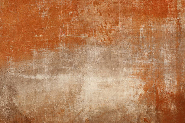 weathered red wall texture in rome, italy - patina stockfoto's en -beelden
