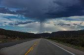Weathered road with rain ahead
