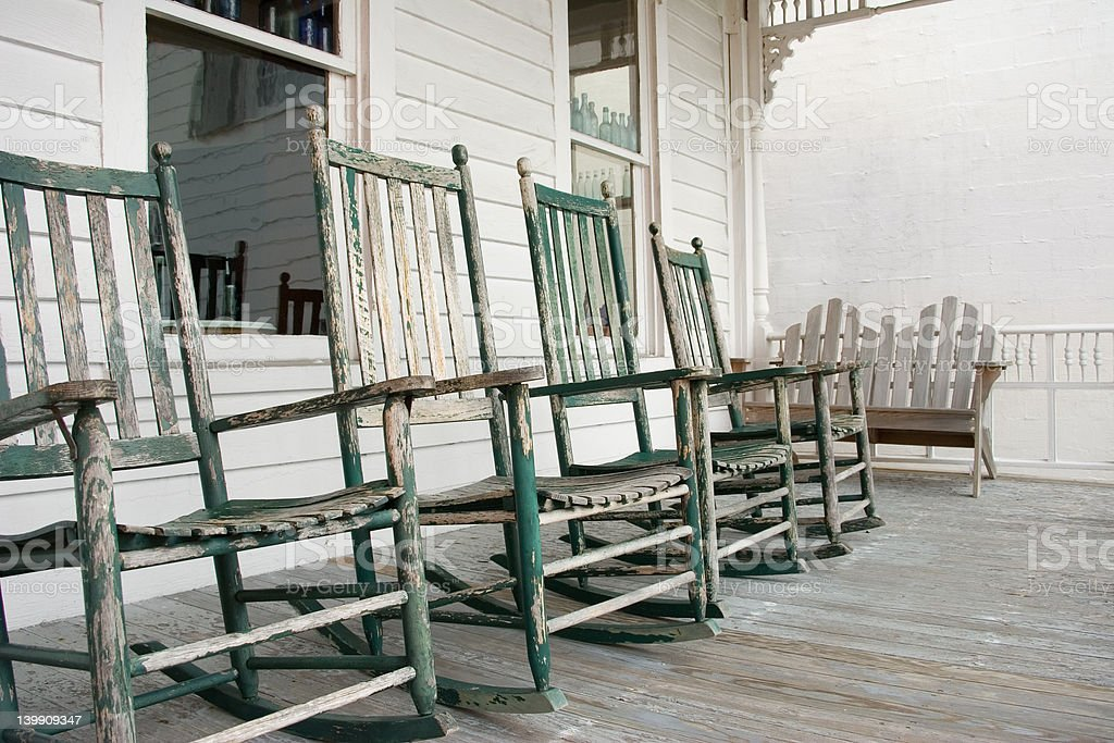 Weathered Rocking Chairs on a Porch royalty-free stock photo