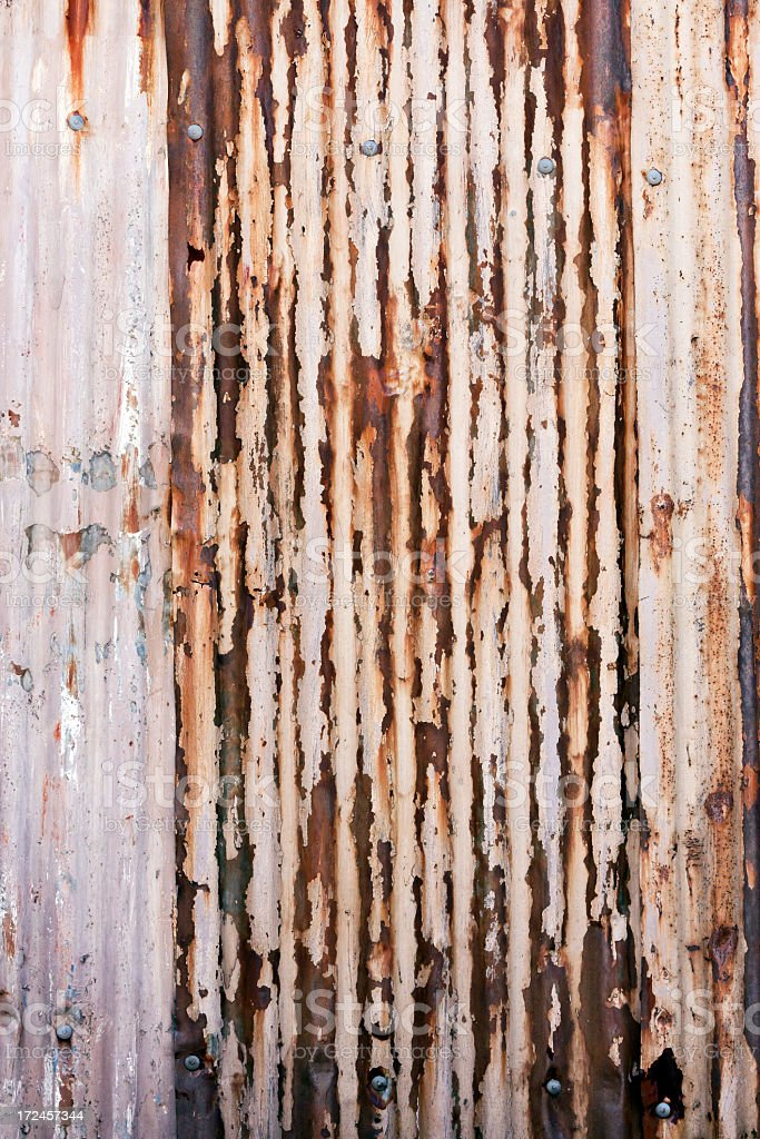 Weathered rusty corrugated iron background with copy space royalty-free stock photo