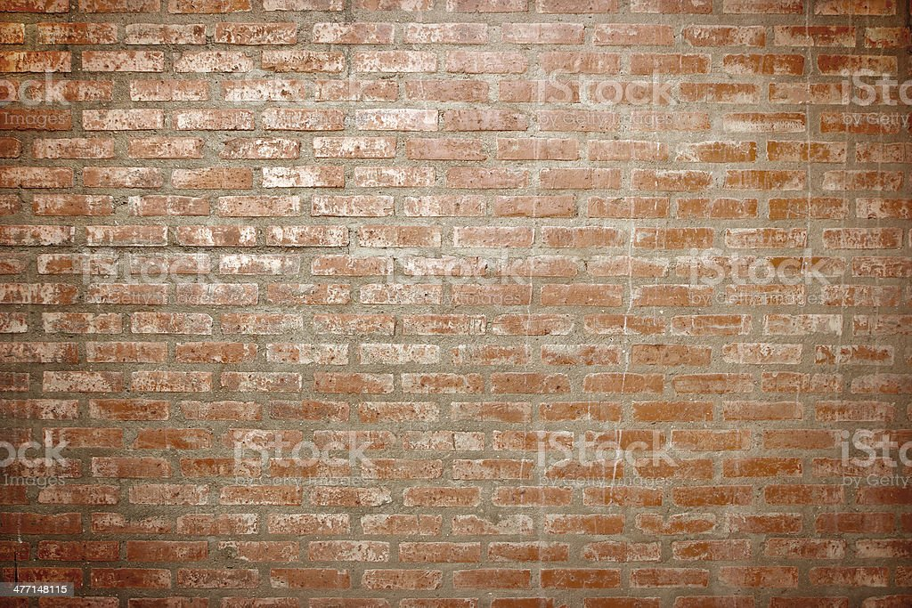 Weathered stained old brick wall background stock photo