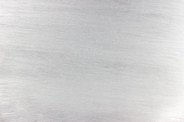 weathered texture of metal, light gray steel surface, background for design stock photo