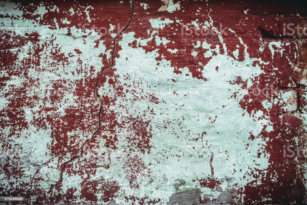 Weathered texture of stained old dark brown and red brick wall background stock photo