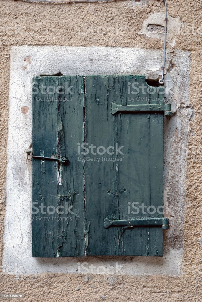 Weathered, textureded door with latch. stock photo