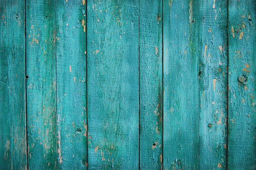 Weathered turquoise wood fencing background