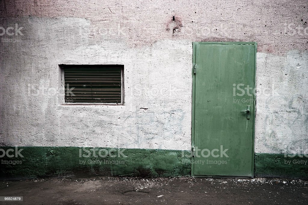 Weathered wall with green door royalty-free stock photo