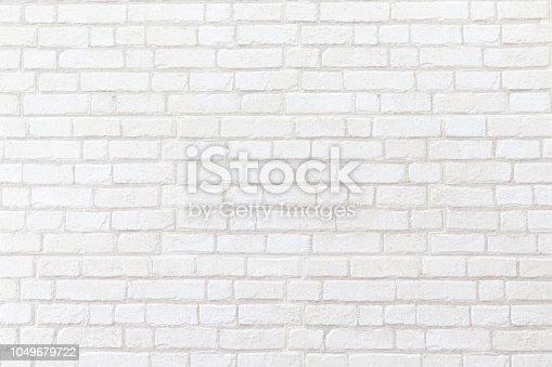 905087856istockphoto weathered white brick wall texture background. 1049679722